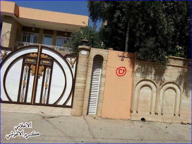 "The Arabic letter ""n"" (inside red circle), signifying ""Nasrani"" (Christian), on an Assyrian home in Mosul."