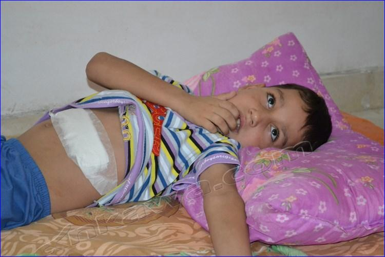An Assyrian child in need of medical attention.