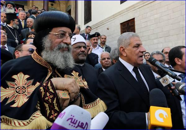 Egyptian Prime Minister Ibrahim Mahlab (R) and Pope Tawadros II (L) of Alexandria at the ceremony for the recent reopening of the Hanging Church, in Old Cairo.