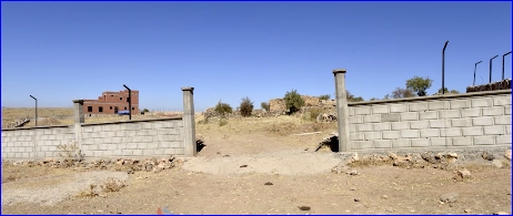 The illegal wall built by a Kurd.