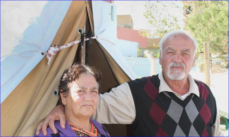 Abu and Um Sabah, pose outside their tent Oct. 26 in a park in Ainkawa, Iraq. One of their sons, Saleh, has traveled to Jordan with his family in the hope of moving elsewhere in the West far from Iraq