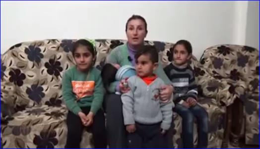 An Assyrian woman and her children who fled from Tel Tamar because of the attacks by ISIS.