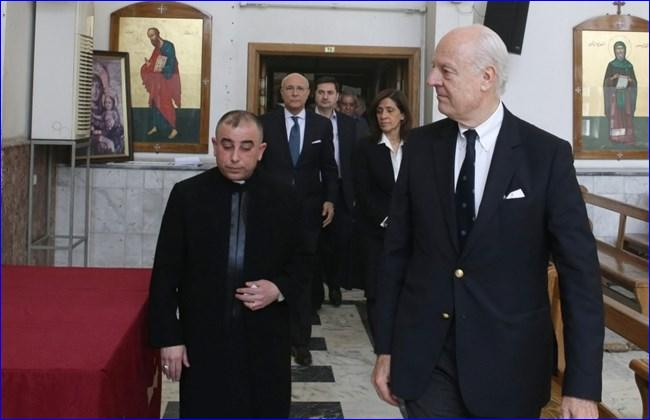 United Nations (UN) special envoy for Syria, Staffan de Mistura (R), stands next to priest Toma Asitivo Kaka during a visit to the Ibrahim-al Khalil Melkite Greek Catholic church to show solidarity with the Assyrian community in the Syrian capital Damascus on March 1, 2015 (AFP PHOTO/LOUAI BESHARA).