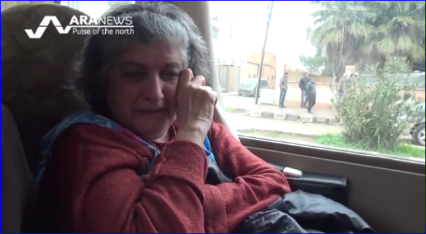 An Assyrian woman breaking in tears while leaving her hometown of Tel Temir after ISIS militants took over several villages in the countryside (photo: ARA News).
