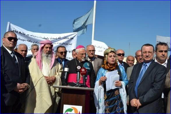 Assyrians, Yazidis and other non-Muslims demonstrate against the forced conversion law in front of the UN mission in Arbel, Iraq.