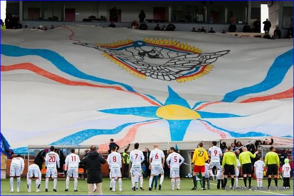 A large Assyrian flag is displayed by Assyrian fans at a game played by Assyriska, an Assyrian football club in Sweden.