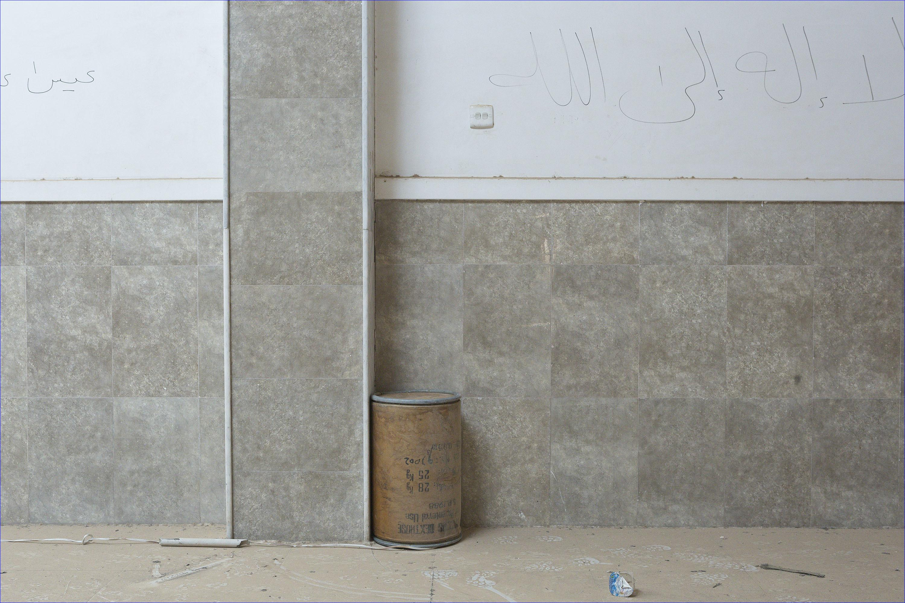 An improvised explosive device, which was set by Islamic State militants to destroy Saint Shmoni Church in Bartella, rests along a wall after being rendered safe by Iraqi Army engineers. Although ISIS militants were pushed back a large amount of improvised explosive devices are still being found in the town's buildings. ( Rex Features/AP)