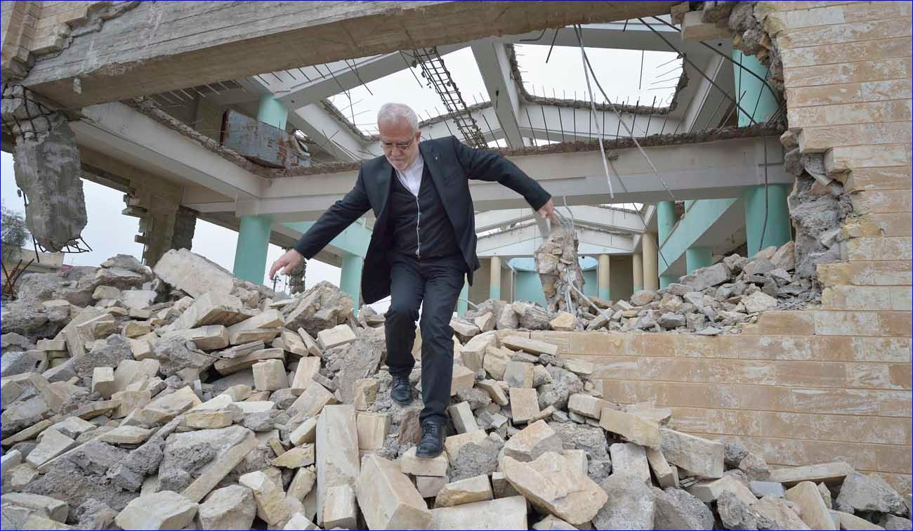 Father Emanuel Youkhana, an archimandrite of the Assyrian Church of the East, walks through the rubble of a demolished church in Mosul, Iraq, Jan. 27. ( CNS/Paul Jeffrey)